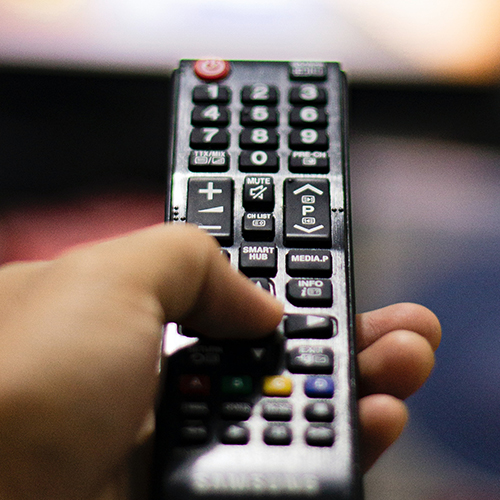 A remote control pointed at a tv