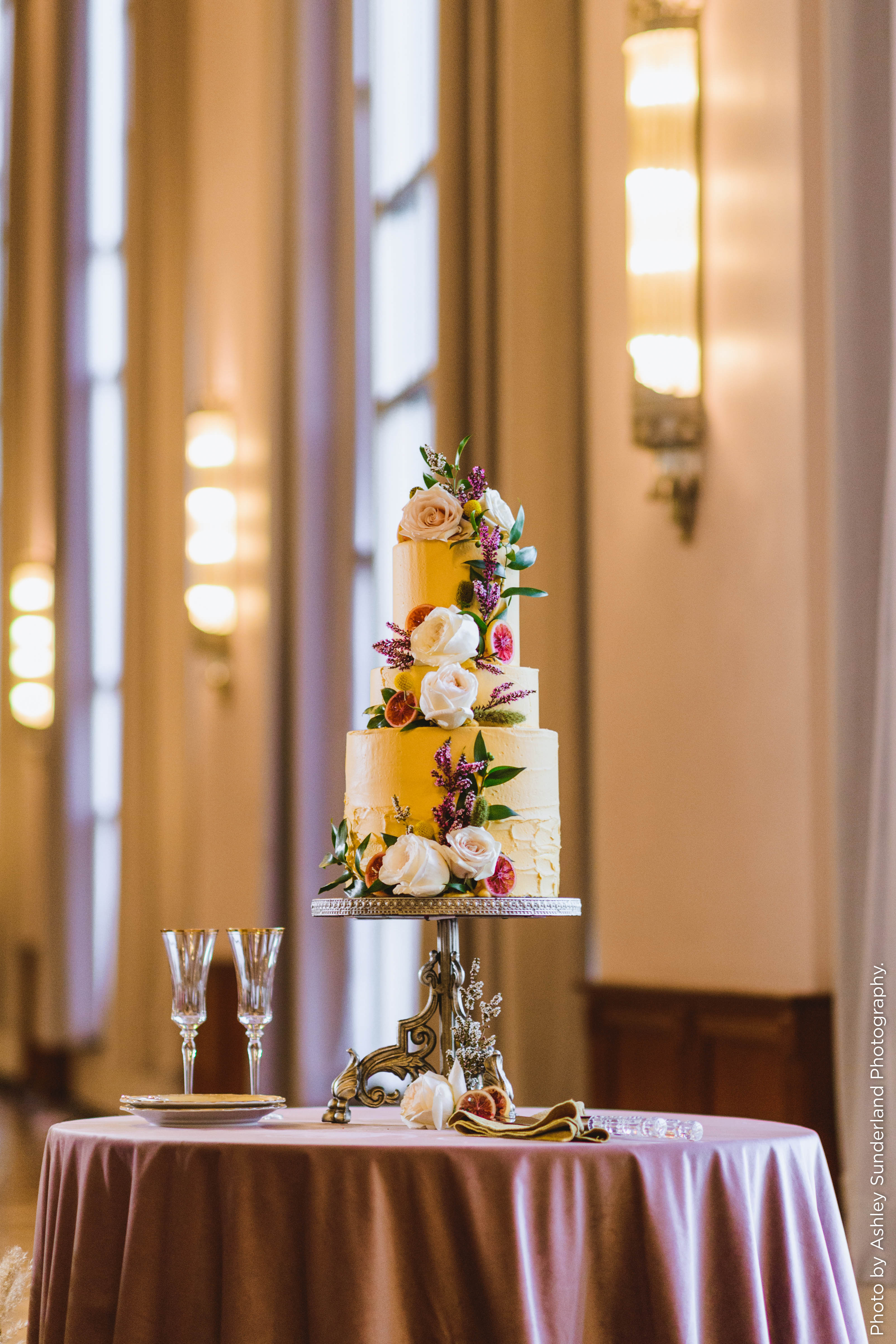 Three tiered cake on a table
